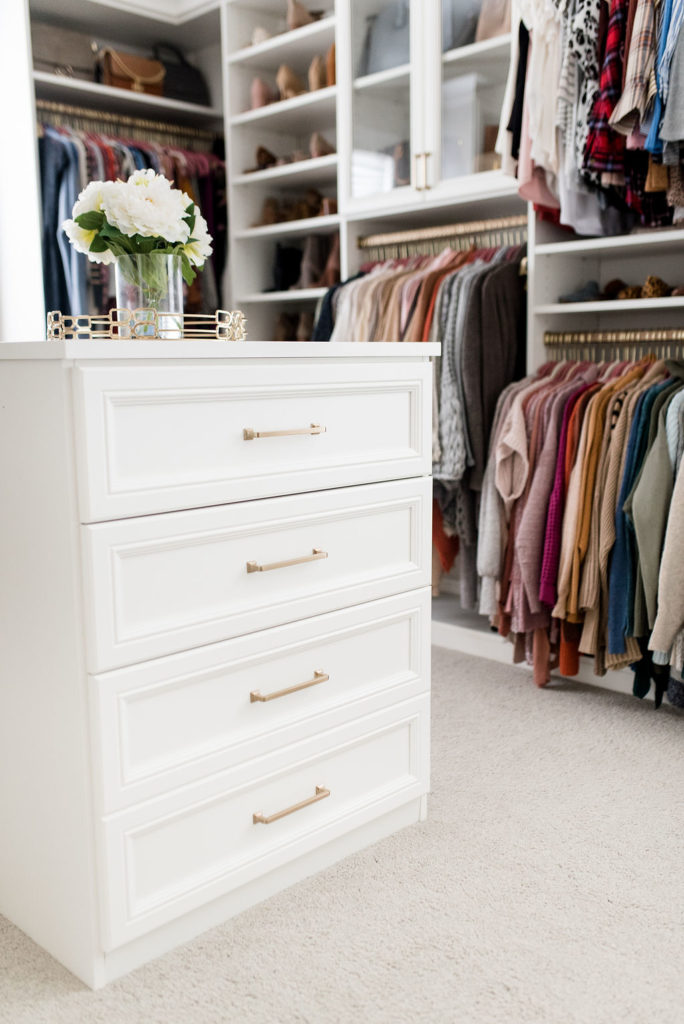 california closets custom walk in closet white drawers gold hardware