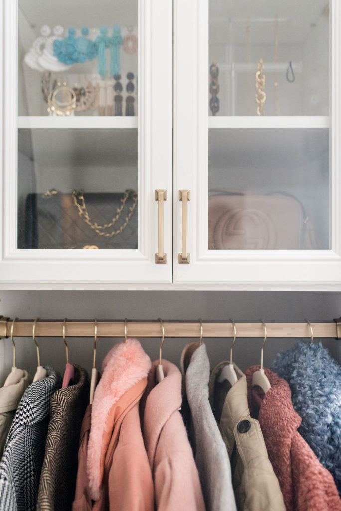california closets glass cabinet for gucci and chanel handbags and jewelry storage