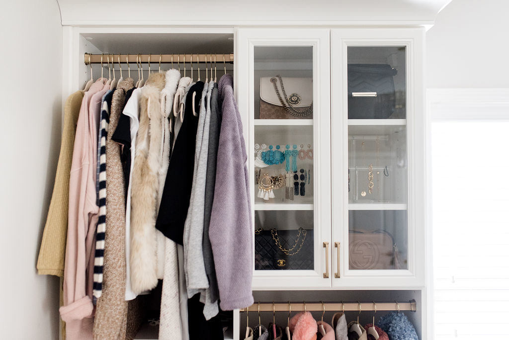california closets rose gold coat hanger and glass cabinet for handbags and jewelry storage