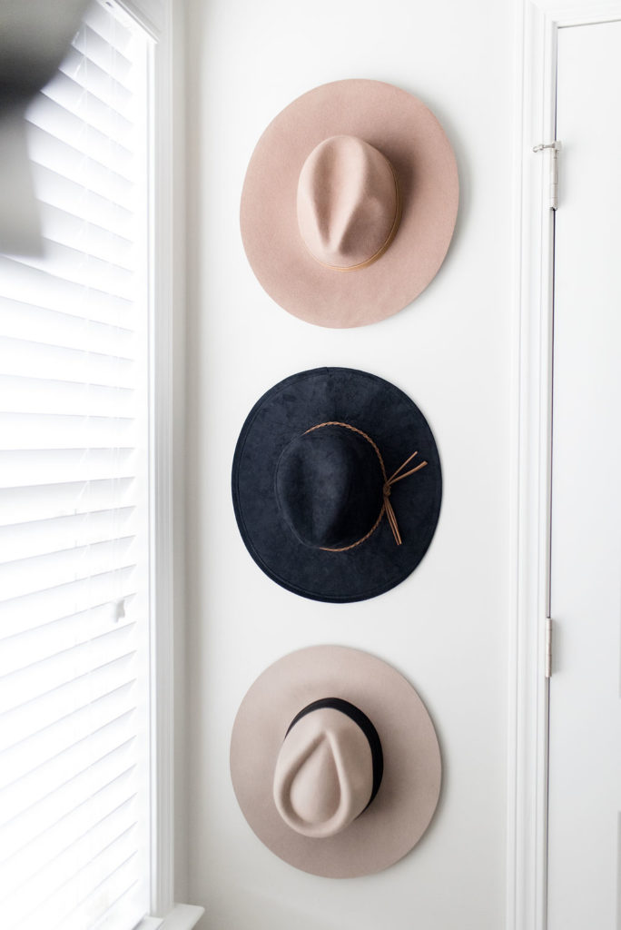 california closets custom walk in hats hanging on wall