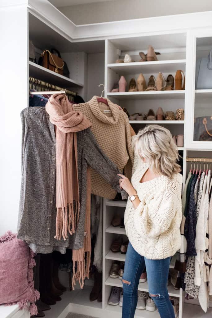 woman in california closets custom walk in closet