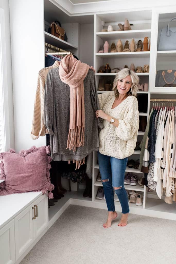 woman in california closets custom walk in with window seat