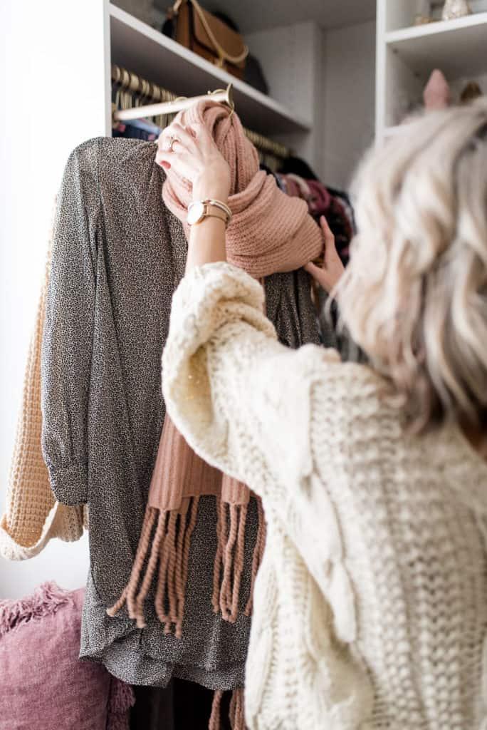 woman in california closet custom walk in