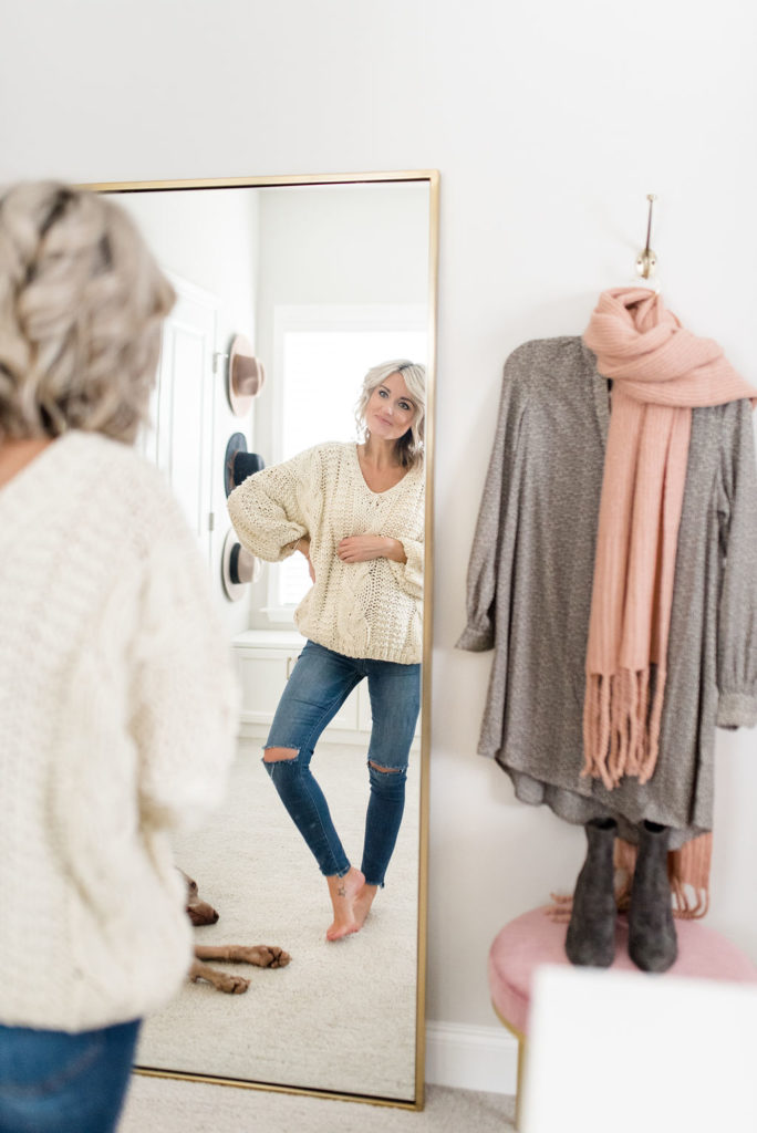 pregnant woman in front of full length mirror in california closets custom walk in