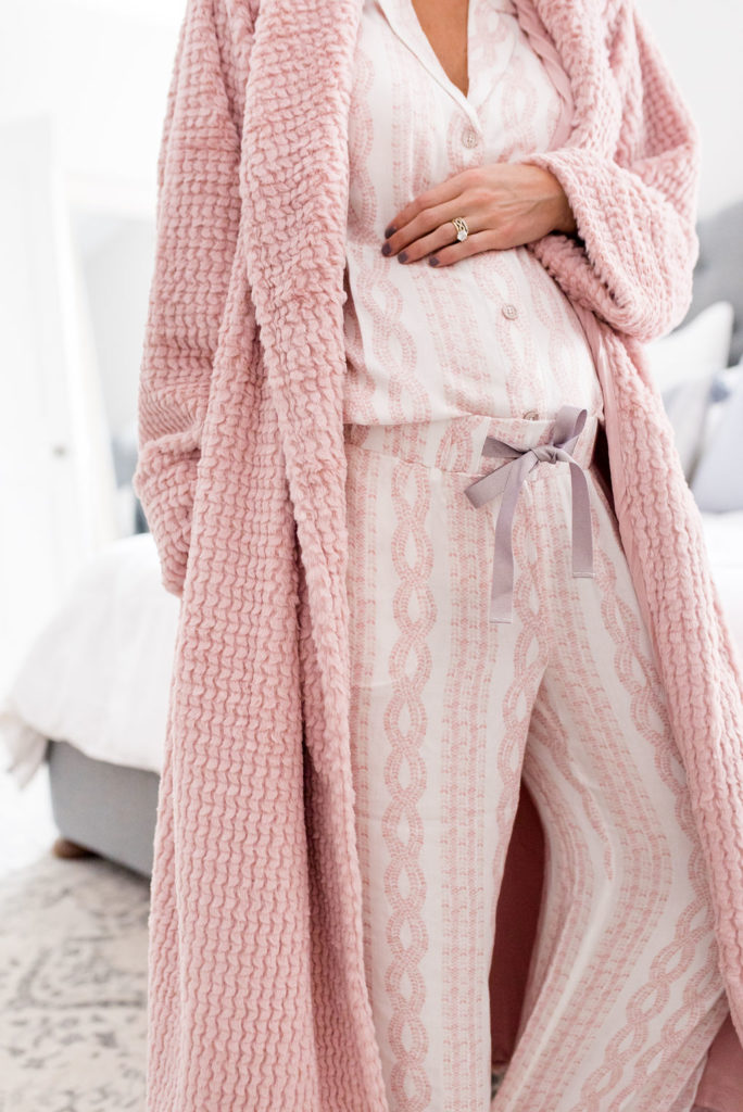 pregnant woman wearing cozy soma intimate matching pink long sleeve and pants pajama set with bath robe