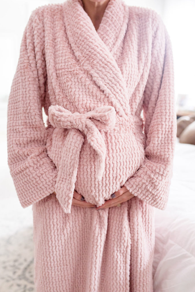 pregnant woman wearing cozy pink soma intimate bath robe