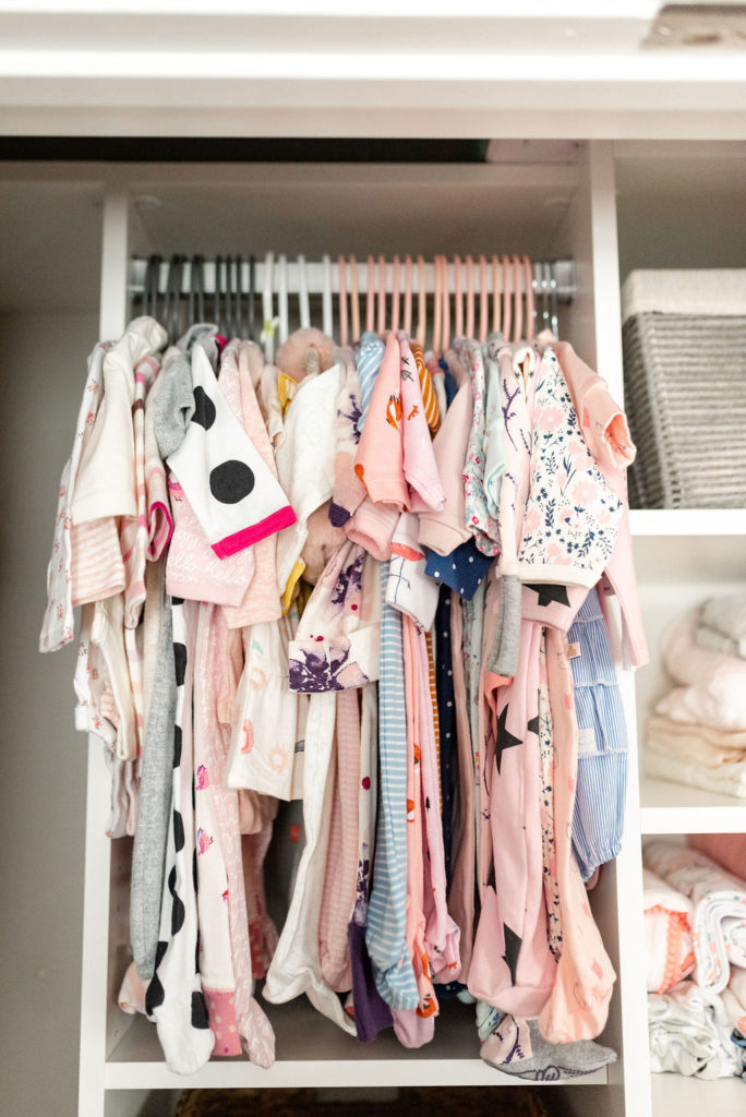 baby clothes hanging in california closets nursery