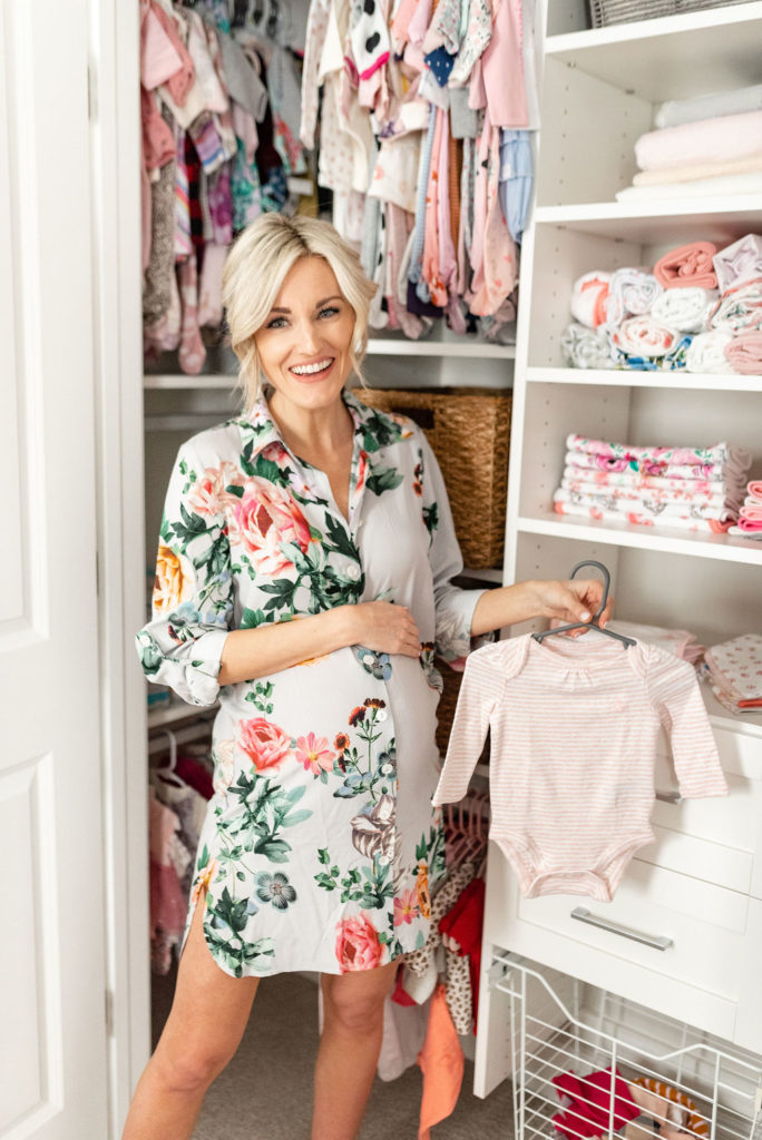 pregnant woman smiling in new california closet baby nursery closet