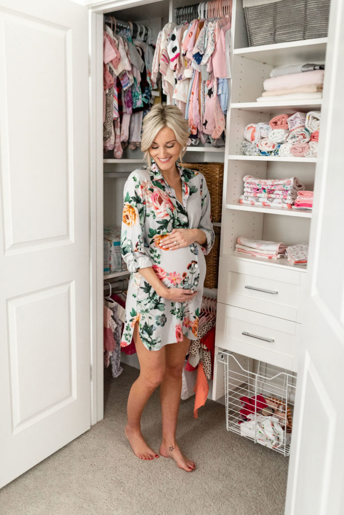 pregnant woman in baby nursery