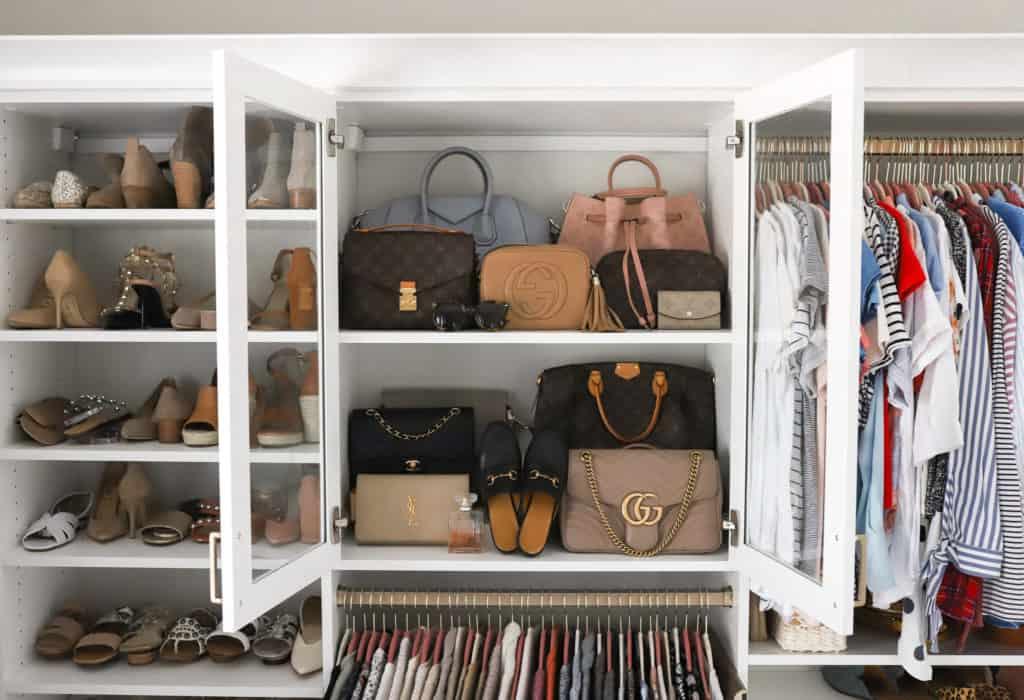 collection of designer handbags on shelf from california closets