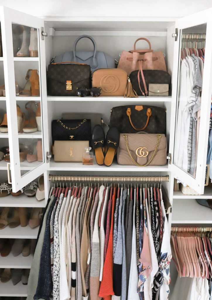 Louis Vuitton, Gucci, Givenchy handbags and princetown mules on closet shelf