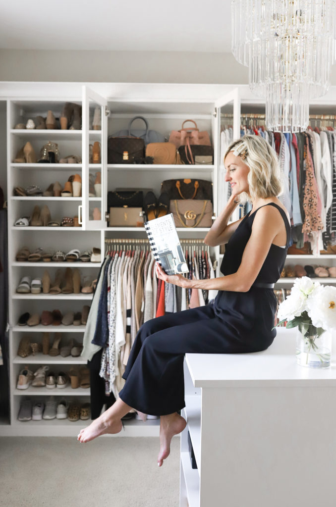 fashion blogger loverly grey with collection of designer handbags in custom walk in closet