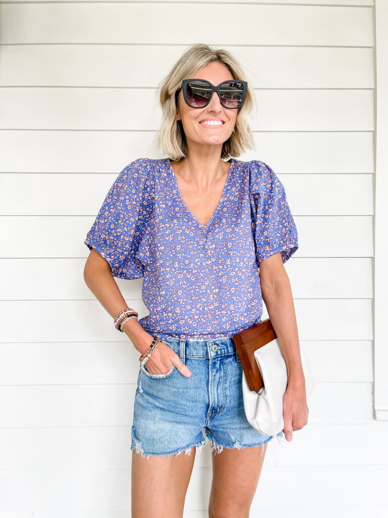 denim shorts and floral blouse